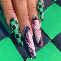 Megan Thee Stallion Shows Off Demon Slayer Manicure